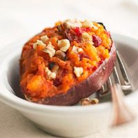 Twice-Baked Sweet Potatoes - 5  medium sweet potatoes (10 ounces each), 1/2  cup  cranberry relish,  1/2  cup  dried cranberries or raisins, snipped or chopped, 2  tablespoons  butter, softened, 1/2  teaspoon  salt, 1/2  cup  walnut pieces, toasted.