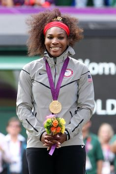 Serena Williams Photos Photos: American Serena Williams seen winning the gold medal by beating Maria Sharapova of Russia in straight sets in the women's tennis single's final held at Wimbledon Tennis Club at the 2012 London Olympic Games Serena Williams Photos, Serena Williams Tennis, Venus And Serena Williams, Women Lawyer, Actress Anushka, Gold Girl, Summer Olympics, African American History, Tennis Players