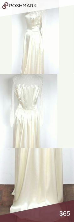 """Vintage 1940s Wedding Dress Ivory Satin and Lace Divine and Gorgeous smooth ivory satin wedding gown from the 1940s. Elegant cut out lace details and pointed cuff sleeves. Metal zipper up side. """"Perfect Junior Toronto"""" Label still attached. Good Vintage condition - small scratch in the satin at the front.  Measurements: Bust: 34"""" Waist: 26"""" Length: 58"""" Shoulders: 16"""" Sleeve to point of cuff: 25"""" Cuff: 8"""" Dresses Wedding"""