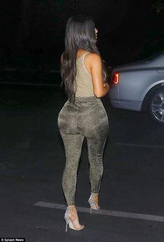 The reality star, 36, rocked a sheer and sparkling tank top along with a pair of trousers that clung to her famous behind as she left La Scala Restaurant earlier this month in Los Angeles.