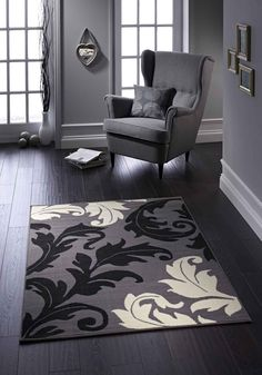 Larger than life floral patterns to suit the most modern decors in style. #floralrugs #greyrugs #durablerugs #modernrugs