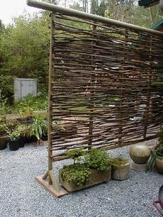 I love this.....a shade screen for a sunny hot side yard. Twig Privacy Fencing or Trellis for Vines....