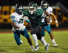 Kecoughtan High's Keith Grady (4) runs past Woodside High's defense during their game held at Darling Stadium in Hampton on Thursday, Sept. 29, 2016.