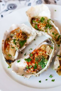 Grilled oysters (baked oysters) - oyster on the half shell with garlic, butter, parsley and paprika. Juicy, briny and crazy delicious | rasamalaysia.com
