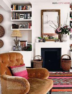 camel/pink/white, built-in shelves, black fireplace, layered look, kilim rug, #livingroom