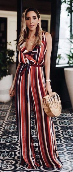 #fall #outfits women's orange, white, and black stripe jumpsuit