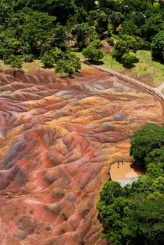The Seven Colored Earth Formation in Chamarel, Mauritius.This natural wonder comprises of sand dunes with seven distinct colors. Mauritius Travel, Mauritius Island, Seychelles, Paradise On Earth, Places Of Interest, Beach Hotels, Beautiful Islands, Holiday Destinations, Natural Wonders