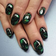 @thenailboss-love these green and black marble nails.
