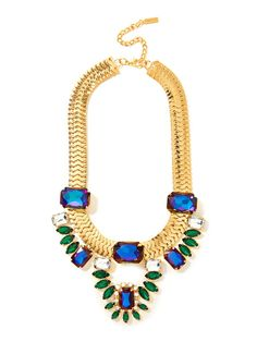 Let this stunning necklace help you achieve spectrum perfection with gorgeous mystic topaz gems that flaunt all the hues of the rainbow, all sizzle and sparkle when set against deep emerald gems.