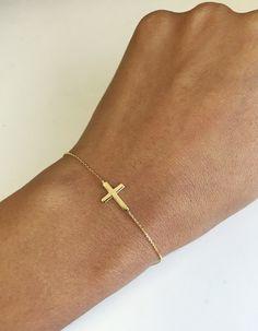 14K Gold Delicate Sideways Cross Bracelet by RondelsJewelry on Etsy https://www.etsy.com/listing/469669359/14k-gold-delicate-sideways-cross