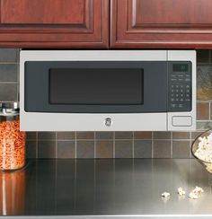 Placement Idea For GE Microwave Oven GE With Trim Kit For Mounting Under  Cabinets