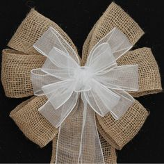 This burlap and white sheer wire edge ribbon bow is created with natural colors and is perfect for any outdoor theme wedding. These bows make a great accent to chair back for holiday decorating too.  Bow Details: 6 loops of 2 1/2 burlap with wire edge. Note: This is real burlap so there may be minor imperfections which is the beauty of burlap. 11 loops of 1 1/2 white sheer with wire edge. Each bow also has 4 tails of the ribbon in the bow Each bow measures 9x 22. Wedding bows are cu...
