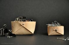 Folded leather basket :: a minimalistic DIY by // Between the Lines //, via Flickr