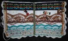 "Sewing Needle Pin Book - A must have for a seamstress to keep all those sewing pins and machine needles in place and easy to find while looking nice near the sewing machine. Great gift item. Made with vintage lace and fabric in a southwestern motif, this book is embellished with leather and blue beads, feathers,gimp,vintage lace, embroidered cover and comes with buttons, pins, threads and needle to start. The size is a great 9"" X 8""."
