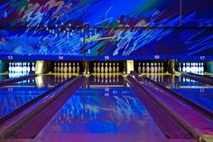 What an attractive bowling alley with abstract wall mural.