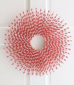 It may just be red and white, but this adorable wreath pops like no other—and it couldn't be more affordable, since it's crafted out of plain paper straws.