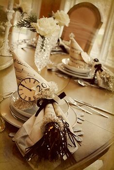 #table settings | NYE, fantastic, home made table setting.  Sheet music hats, treat cones, and LOVE the rose in the wine glass!