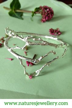 Cast from real budding branches. This really is a pleasure to wear just like have a a vine growing around your wrist but in opulent Sterling Silver. Gold Hands, Pretty In Pink, Pink Flowers, Studs, Lime, Jewelry Making, Hair Accessories, Sterling Silver, Tree Branches