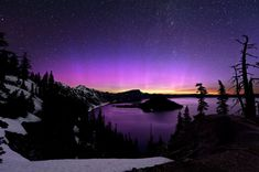 Crater Colors  Photograph by Brad Goldpaint    During a particularly intense solar storm—triggered by titanic eruptions on the sun Friday—a kaleidoscope of auroral colors paints the sky over Crater Lake, Oregon, early Sunday.