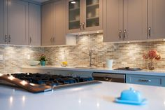 Marbleized 1 x 4 50% Burlywood Pearl, 50% Burlywood Silk used in a kitchen backsplash at Stone & Pewter Accents