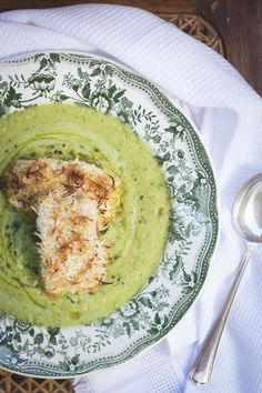 COCONUT FISH FINGERS on PEA AVOCADO SOUP with OLIVE OIL, CILANTRO, MINT & LEMON ZEST SPIRALS ~~~ the fish's coating is simple and light; carolina goes for coconut sans bread crumbs. [amesadacarolina]