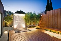 Large #deck with nice landscaping which includes a glass fountain and good positioned lighting.
