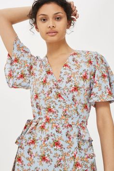 As if we didn't love wrap dresses enough, this number arrived. With a beautiful confetti floral print, we'll be taking this from festivals to holidays and every summer activity in our book.
