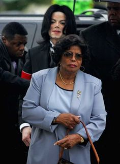 FILE - In this Monday, Feb. 28, 2005 file photo, Michael Jackson follows his mother, Katherine Jackson, as they arrive for court on the opening day of his child molestation trial at Santa Barbara County Superior Court in Santa Maria, Calif. Katherine Jackson has been reported missing, but the Los Angeles County Sheriff's Department says she may be with family members. The agency says another family member reported her missing Saturday night, July 21, 2012 because he couldn't speak with her…