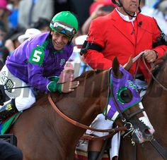 Victor Espinoza is gives California Chrome a pat on the neck after winning the 140th running of The Kentucky Derby Saturday evening May 3, 2014. Skip Dickstein Photo