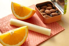 Lift your spirits with the perfect snack pack: tangy oranges, almonds and a #cheese stick!
