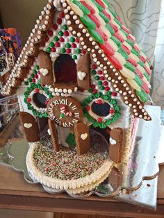 Beautiful Bavarian style clock gingerbread house.