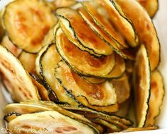 Zucchini Chips: thinly sliced zucchini, olive oil, and sea salt, baked crispy. Betcha cant eat just one.