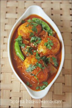Bengali Egg Curry        4 eggs 1 large potato, 4 tbsp oil 1 cup chopped onion 1/2 cup puréed tomatoes (fresh or store-bought) 1 1/2 tsp ginger paste 1/4 tsp garlic paste 3 or 4 green chillies, slit (more or less according to your taste) 1/2 tsp paanch-phoron (see above for recipe) 1/2 tsp turmeric powder 1 tsp cumin powder 1/2 tsp Kashmiri chilli powder 1/2 tsp red chilli powder (if you want more fire in your... http://www.travel-bangladesh.net/