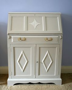 painted this desk on commission.  2 tones limed white