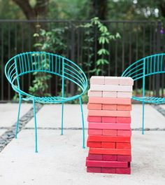 Pink jenga game | Veda's bright boho 1st birthday by Blue Lotus | Photos by Sarah Kate Photo | 100 Layer Cakelet
