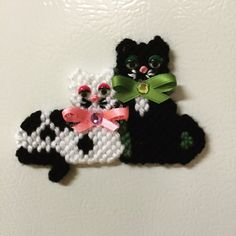 Two black and white cats in plastic canvas  by Cathygiftsandthings