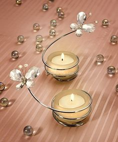 Butterfly wedding themes are great for anyone planning a wedding in the spring or summer months! Candle Wedding Favors, Candle Holders Wedding, Beach Wedding Favors, Wedding Decorations, Wedding Themes, Butterfly Wedding Theme, Butterfly Party, Wire Crafts, Diy And Crafts