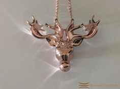 Mistletoe Reindeer Pendant 3d printed Rose gold plated brass on white silk (Chain not included)