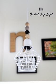 I love how this cheap cage light gets a 'Nordic' make-over. DIY Beaded Cage Light via Nalle's House Diy Design, Outdoor Light Fixtures, Outdoor Lighting, Do It Yourself Regal, Diy Deco Rangement, Cage Light, Blog Deco, Diy Interior, My New Room