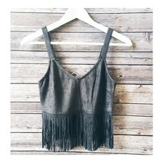 • Charcoal Fringe Crop • Beautiful charcoal grey color, faux suede, fringe crop top. Sleeveless. So adorable! Great for those music festivals. Recommend going with your normal size. Has stretch to it.    90% polyester, 10% spandex.   No trades. Price firm. PLEASE DO NOT purchase this listing. Comment below what size you need and I'll make you a listing Jennifer's Chic Boutique Tops Crop Tops