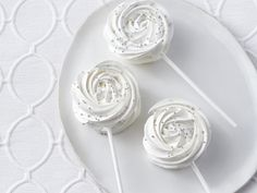 """Meringue Lollipops recipe from Food Network Kitchen via Food Network; can also pipe clusters with small star tip for """"meringue poinsettias"""" Best Christmas Recipes, Christmas Desserts, Christmas Treats, Christmas Fun, Holiday Recipes, Christmas Cookies, Easter Recipes, Holiday Treats, Christmas Baking"""