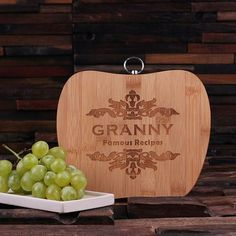 Affordable bamboo wood cutting board, laser engraved and monogrammed custom with nifty ring to hang. We can do anything you need. We have a team of designers that will create for you (no additional fe