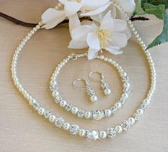 A personal favorite from my Etsy shop https://www.etsy.com/listing/466098640/swarovski-crystals-and-pearl-necklace