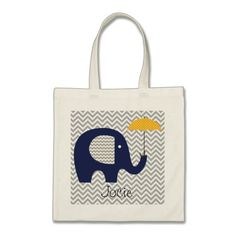 A cute elephant design tote bags sure to please both kids and adults who love elephants, features a cute navy blue elephant with gray chevron striped ears and a yellow polka dotted umbrella on an gray and white zig-zag striped background. #animals #kids #personalized #customized #add #name #elephants #safari #zoo #animals #cute #stripes #chevron #cheery #mammals #bright #custom #umbrella