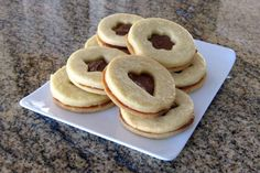 Classic sugar cookies are iced with an easy cookie icing or filled with your choice of dulce de leche, ganache, or jam.