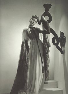 """Horst P. Horst: Robe du soir Madeleine Vionnet, été 1938. Madeleine Vionnet designed this. Called the """"Queen of the bias cut"""" and """"the architect among dressmakers"""", Vionnet is best-known today for her elegant Grecian-style dresses and for introducing the bias cut to the fashion world."""