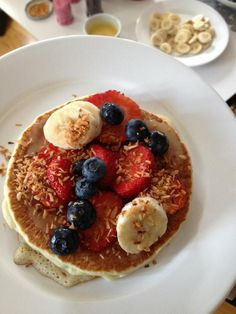 Pancake inspiration: Banana, blueberry, strawberry and roasted coconut. Ground layer is key lime toping