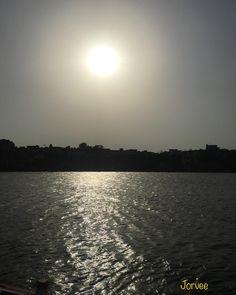 The Sun above the Ganga River and its reflections in river at Banaras.  #lovebanaras #varanasi #river #ganga #RiverGanga #boat #ghats and #faith #Jorvee's #photography #sun #fire #water #view #underwater #rays #delhi #india