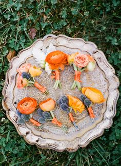 orange ranunculus + blue thistle boutonnieres | Ashley Cox