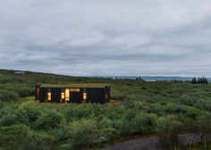 Batons of charred timber and layers of turf help this pair of holiday cottages by PK Arkitektar settle into the rugged landscape of south-west Iceland